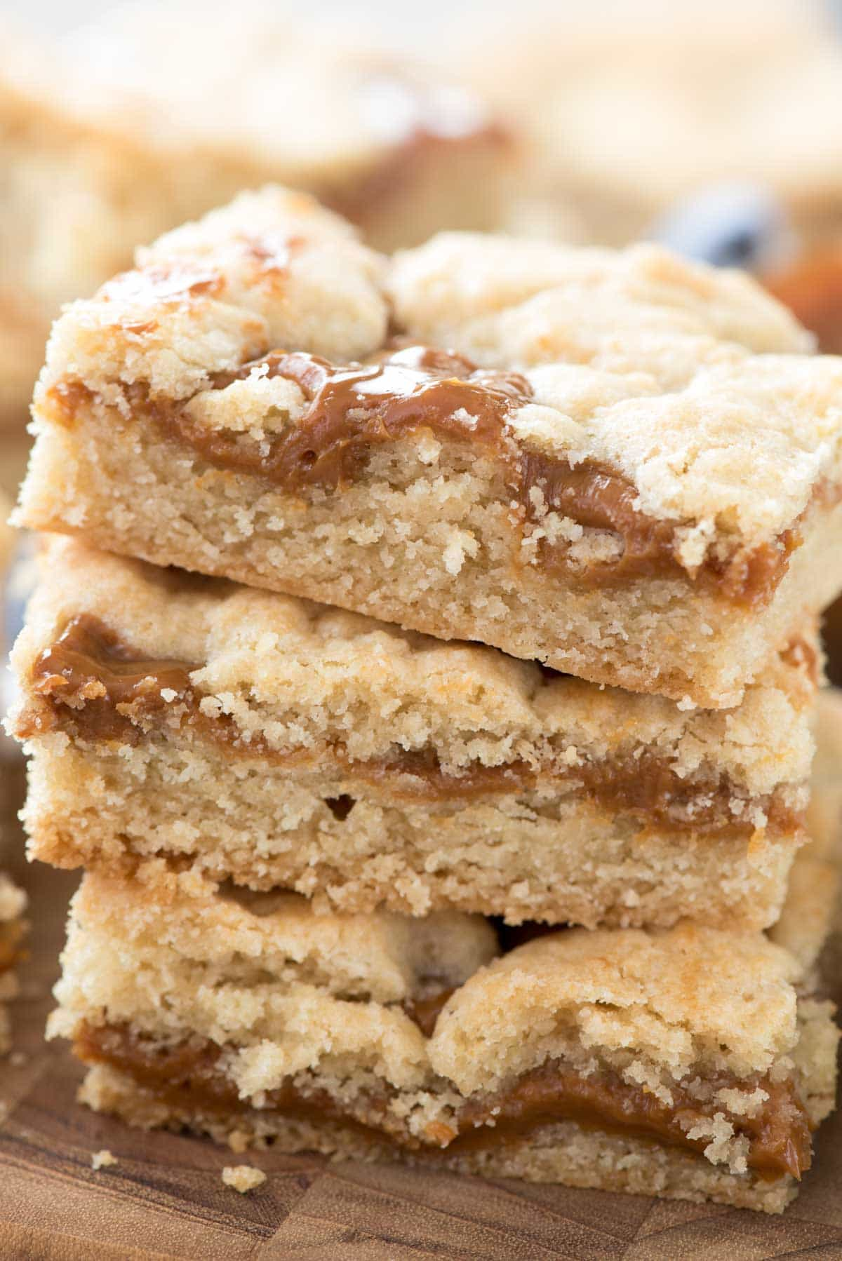 Dulce de Leche Gooey Bars - this EASY sugar cookie bar recipe has gooey dulce de leche inside! Cookie bars with caramel are always a hit!