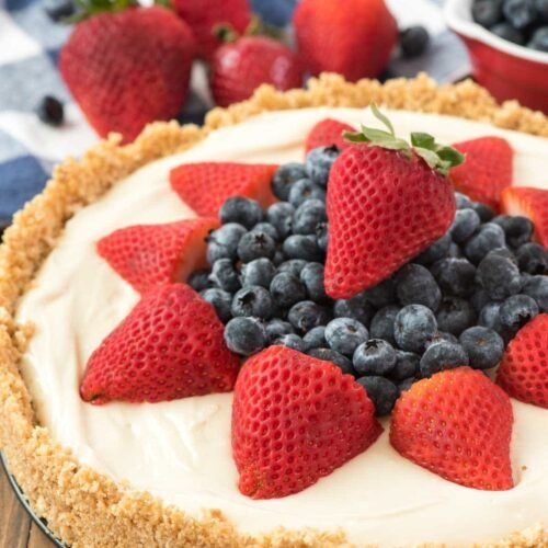 This is THE BEST NO BAKE CHEESECAKE RECIPE EVER! It's got a thick graham cracker crust and an easy filling. Everyone loves this easy no bake cheesecake recipe!