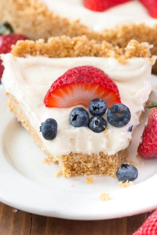 The BEST No Bake Cheesecake Recipe - this easy cheesecake recipe is completely no bake! It has a thick graham cracker crust and a sweet cheesecake filling. Perfect for Summer!