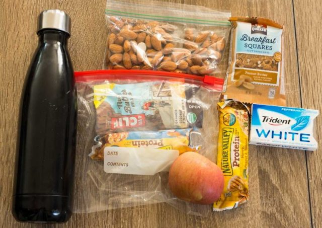Carry On Essentials - water and snacks!