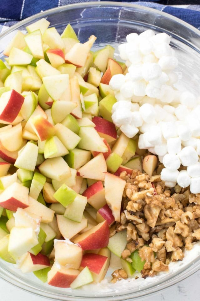 Apple Cheesecake Fluff Salad - an easy no bake cheesecake mixed with apples, walnuts, and marshmallows.