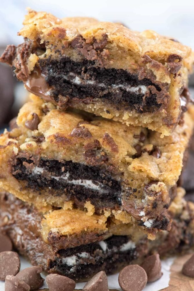 oreos stuffed inside cookie bars in a stack