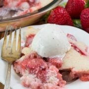 Easy Strawberry Cobbler on a white plate with a fork