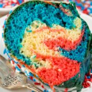 Fireworks Bundt Cake on a plate with a fork - perfect 4th of July dessert!