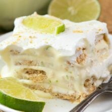 Easy No Bake Key Lime Eclair on a white plate with a fork