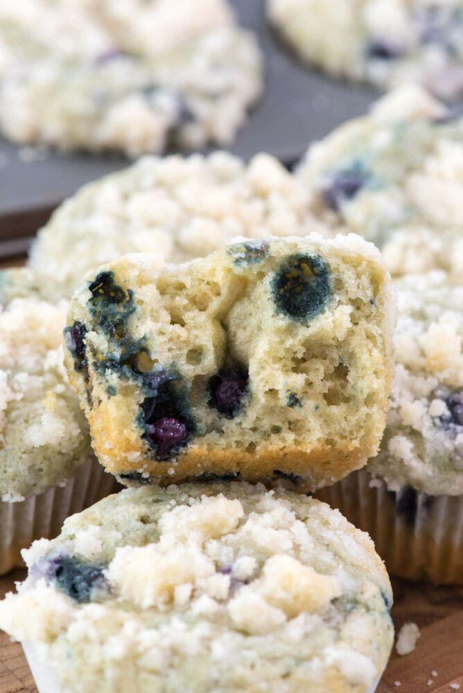 Starbucks Copycat Blueberry Muffin sitting in a stack with bite missing