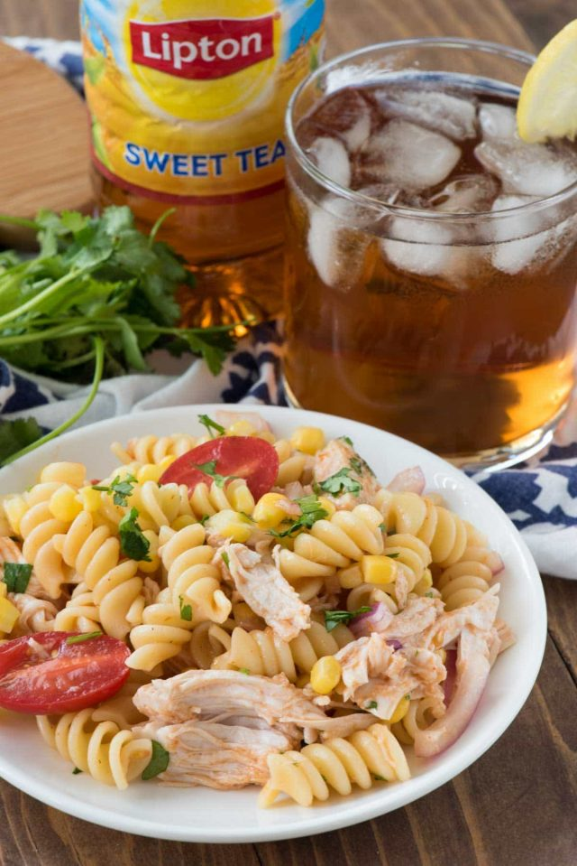 EASY BBQ Chicken Pasta Salad - this yummy pasta salad recipe is full of corn, tomatoes and chicken and dressed with a BBQ sauce vinigarette! It's the perfect easy weeknight meal or potluck pasta dish.