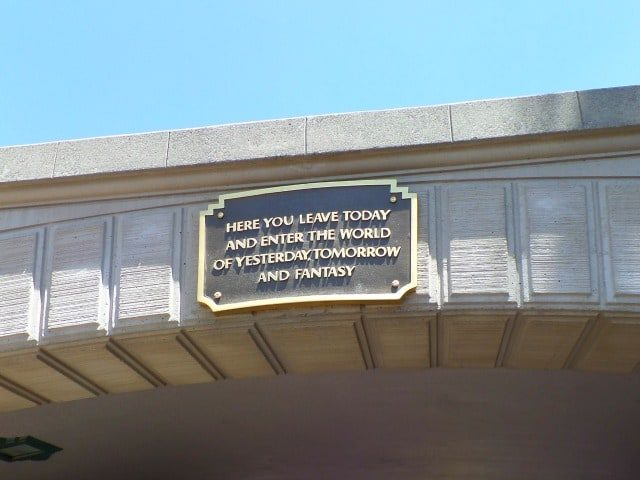 """photo of the bridge at Disneyland with plaque """"here you leave today and enter the world of yesterday tomorrow and fantasy"""""""