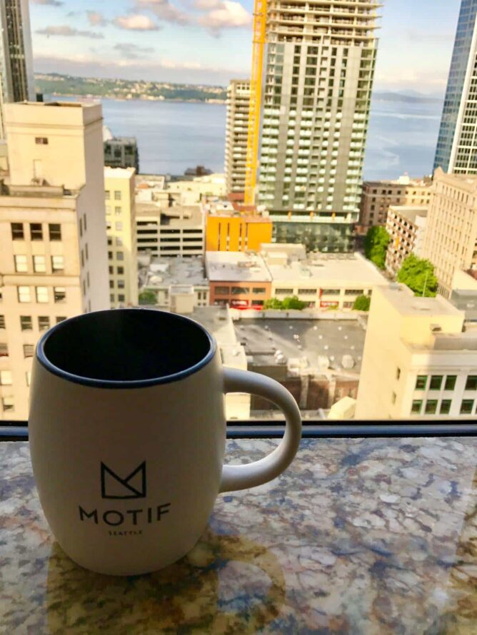 cup of coffee on windows from  Motif Hotel