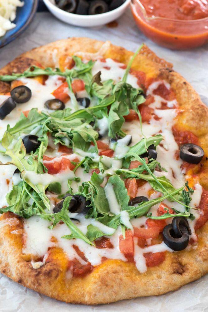 Arugula Pizza on parchment paper