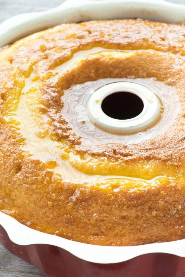 Easy Lemon Butter Cake in pan soaked with lemon glaze