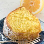 slice of lemon butter cake on blue plate