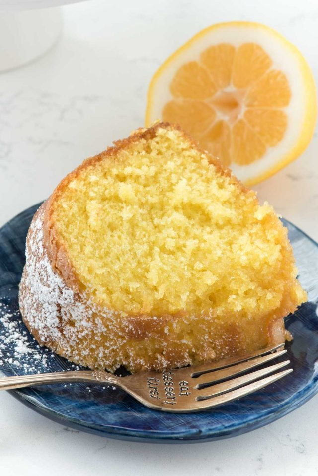 Easy Lemon Butter Cake starts with a cake mix and has the perfect lemon flavor. The warm cake is soaked with a lemon butter sauce!!