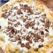 pesto pizza with mushrooms and sausage