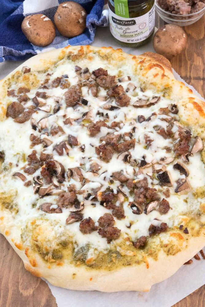 Sausage and Pesto Pizza on parchment paper