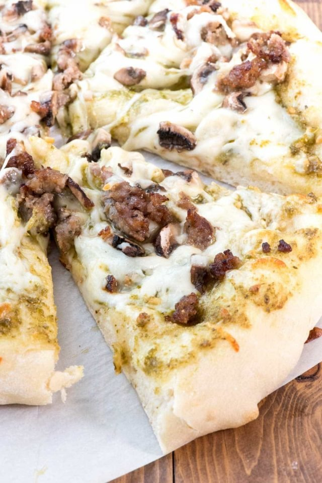 Mushroom Sausage Pesto Pizza - everyone loves pizza night! This easy dinner recipe has pesto for the sauce and it goes so well with the sausage and mushroom topping!