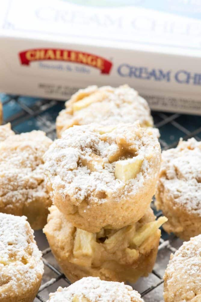 Apple Cheesecake Cookie Cups in a stack with challenge cream cheese behind