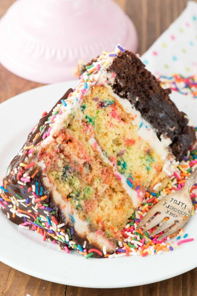 Funfetti Brownie Layer Cake - this cake is easier than it looks! There's a layer of brownie and two layers of confetti cake, filled with a cream cheese frosting and topped with a hot fudge chocolate drizzle!