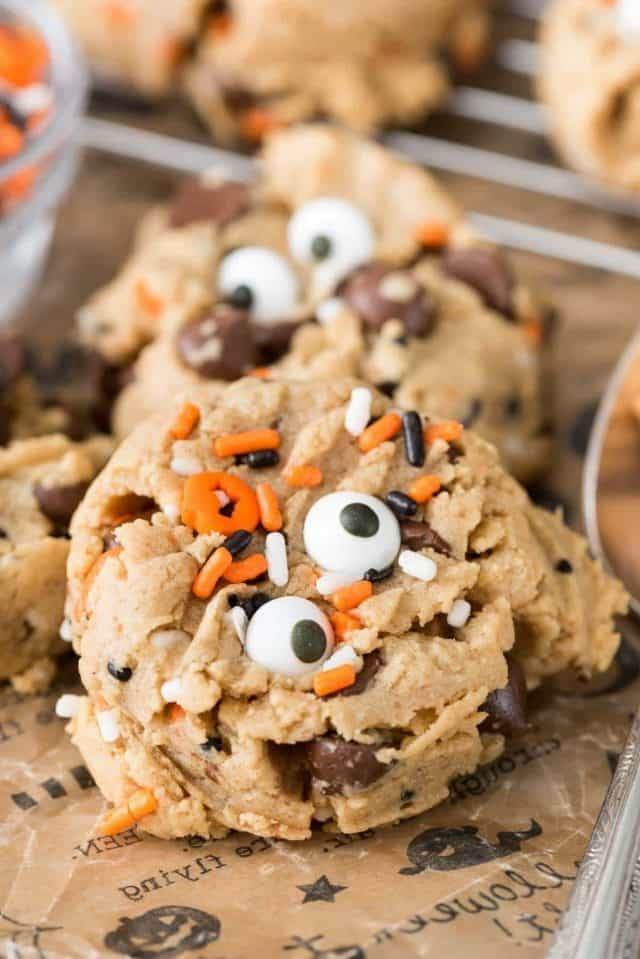 Peanut Butter Pudding Cookies with black and orange sprinkles and spooky candy eyes