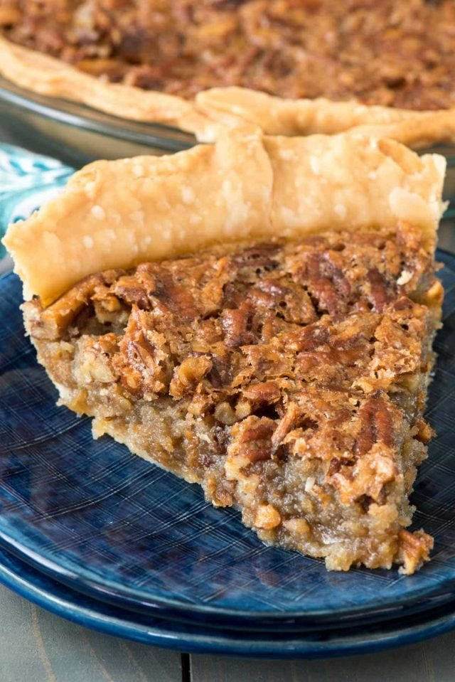 Brown Sugar Pecan Pie - this easy and fast pecan pie recipe has no corn syrup and is FULL of brown sugar. It's our family favorite and disappears in minutes every time I make it!