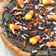 cookie cake with black frosting and halloween sprinkles