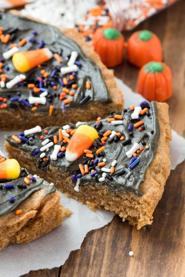 EASY Halloween Pumpkin Cookie Cake - the most fun Halloween treat! Thanks to a Krusteaz Pumpkin Cookie mix this recipe is made in minutes and all you need are some Halloween sprinkles to make it your kids new favorite dessert recipe.