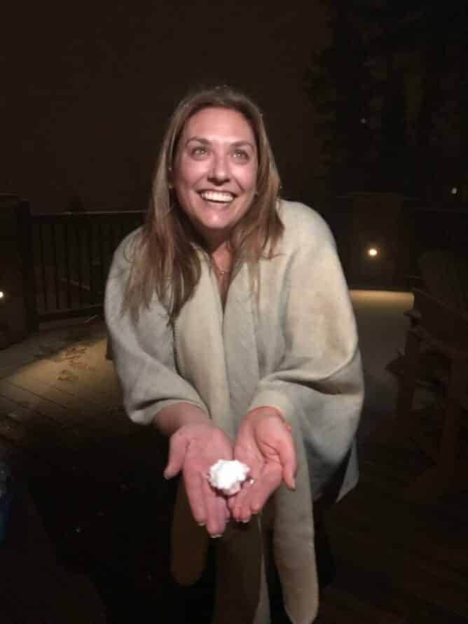 Picture of woman holding a snowball at night