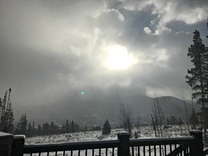 View from Cabin deck with snow on ground and sun coming through clouds