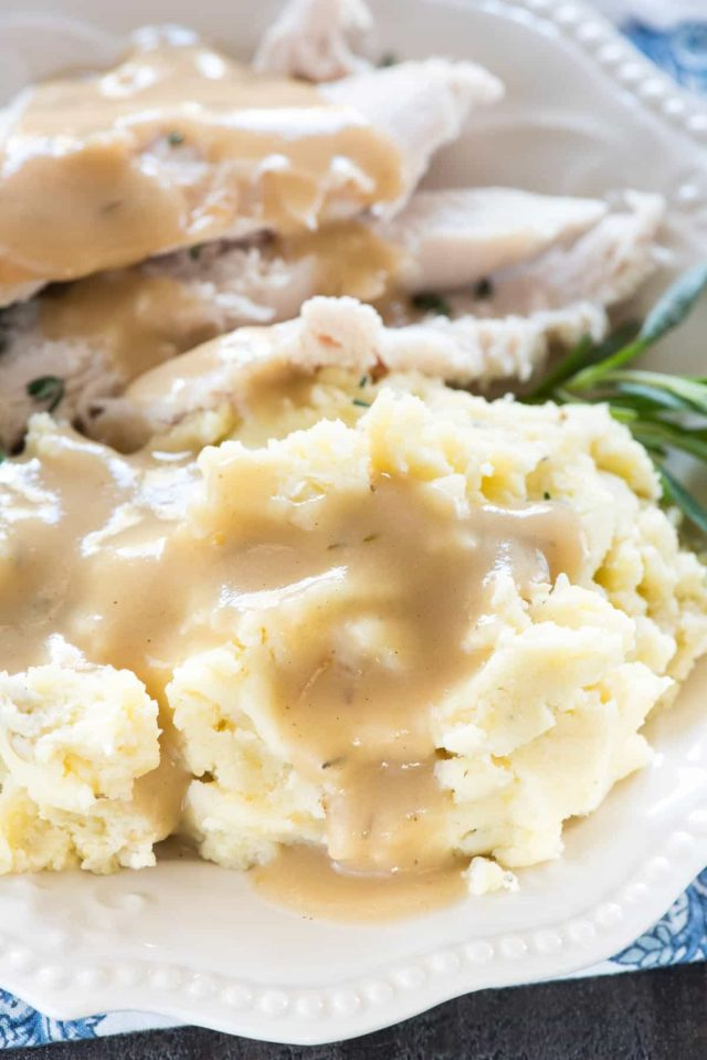These simple and Easy Crockpot Mashed Potatoes come together in minutes - you set it and forget it so you can make all the other sides! It's crazy how good they are from the slow cooker!
