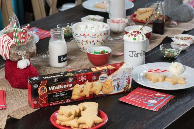 Table set up with Walkers Shortbread cookies and all ingredients to decorate the cookies