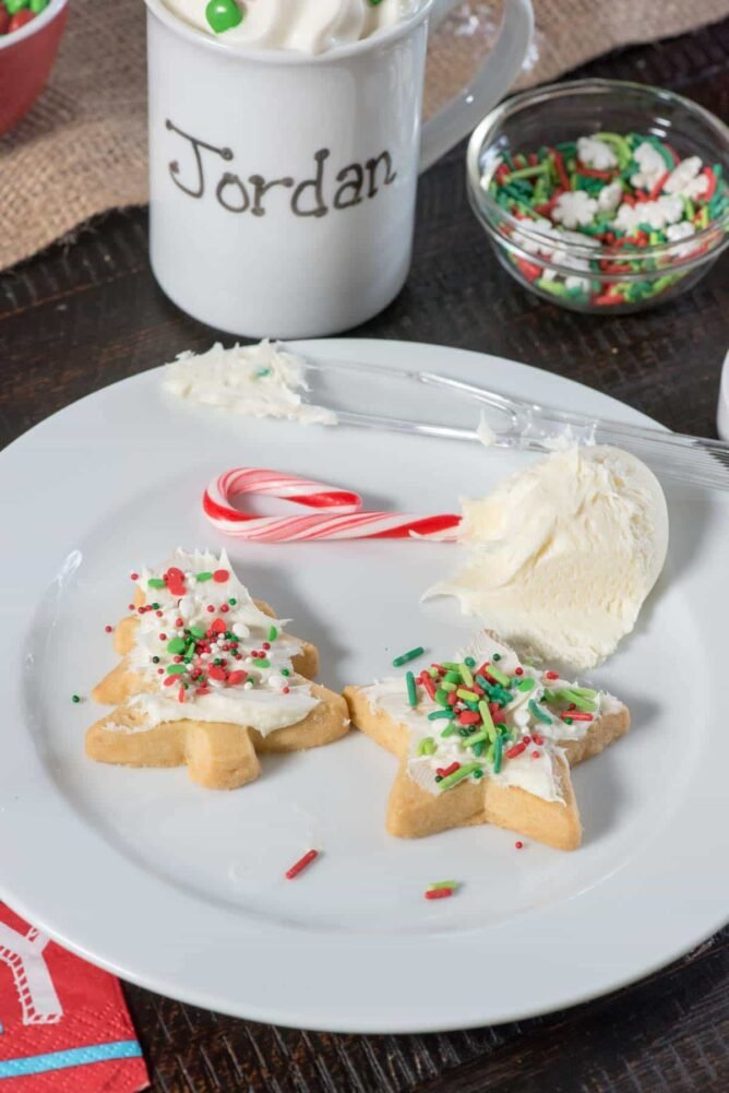 White plate with Christmas cookies and a mug in the background