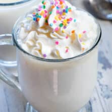 Spiked Crockpot White Hot Chocolate made with coffee creamer for flavor and cake vodka to make this takes like a birthday cake hot chocolate!