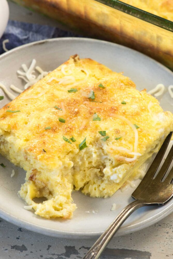 Cheesy Green Chile Egg Casserole on a white plate with a fork
