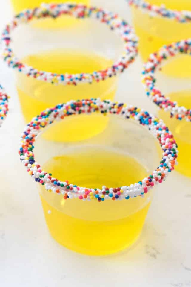 Lemon Cake Jell-O shots stack with sprinkles