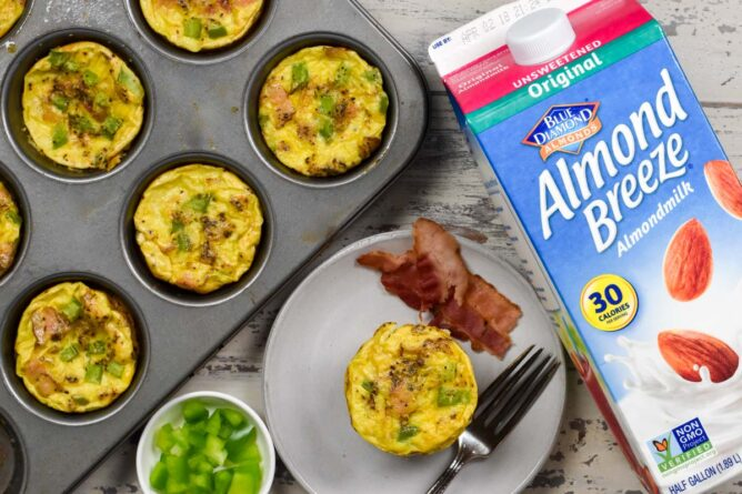 muffin tin of egg muffins with almond milk carton