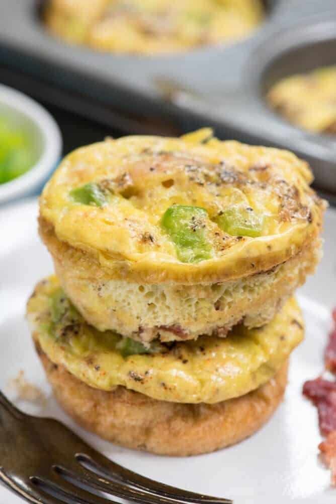 stack of egg muffins on a white plate with a fork