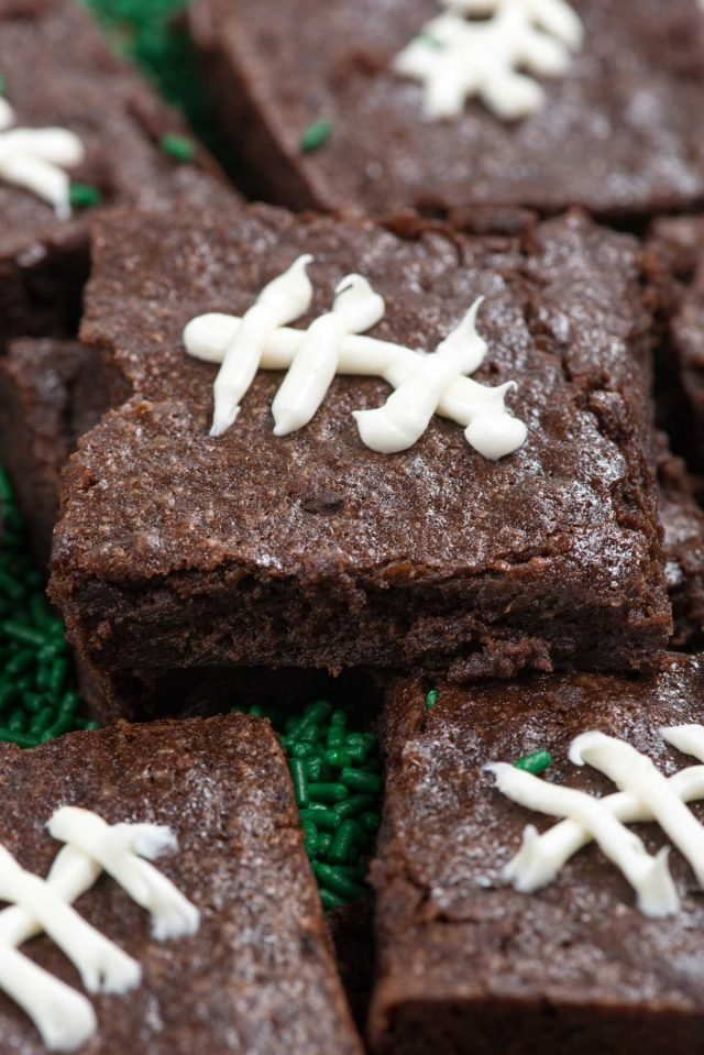 stack of brownies decorated like footballs