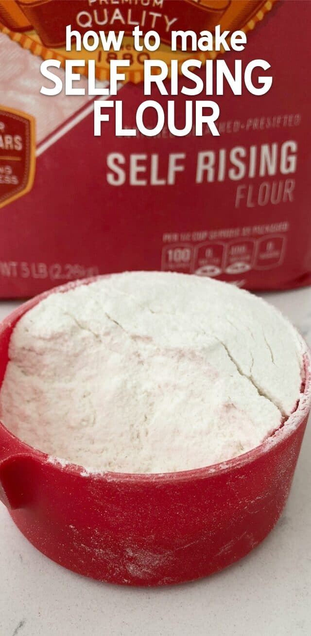 Flour in a red measuring cup with writing and a bag of flour