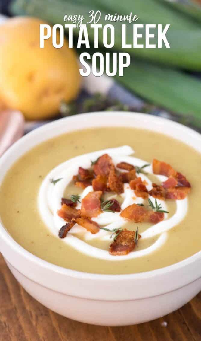 Potato leek soup in a white bowl with writing