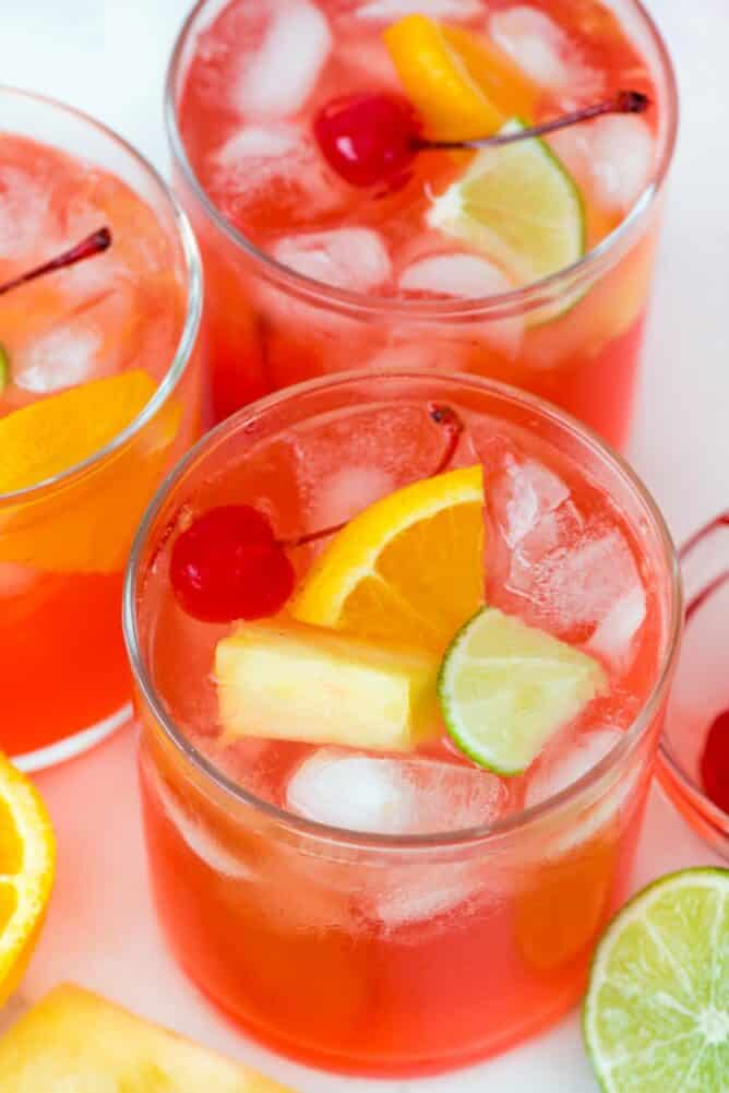 three glasses with vodka party punch and fruit