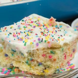 slice of funfetti cake on plate