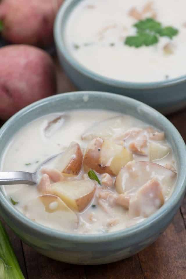 bowl of clam chowder with spoon inside
