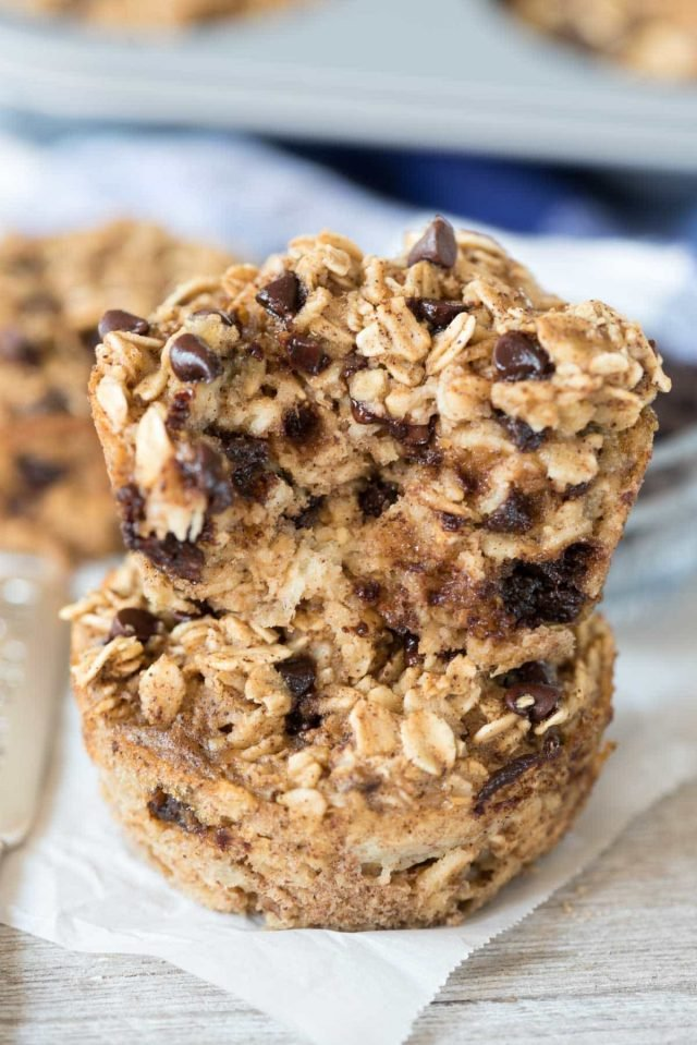Stack of chocolate chip baked oatmeal muffins on parchment paper