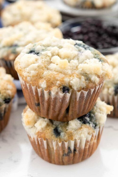 Stack of Blueberry Cream Cheese Muffins on a counter