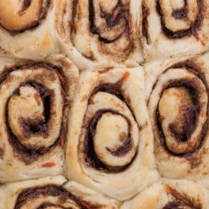overhead shot of pan of unfrosted cinnamon rolls