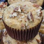 stack of banana nut muffins in brown liners