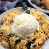 dump cake on white plate with ice cream