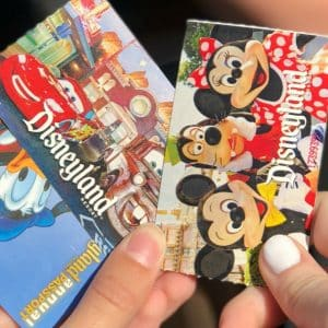 hands holding Disneyland tickets