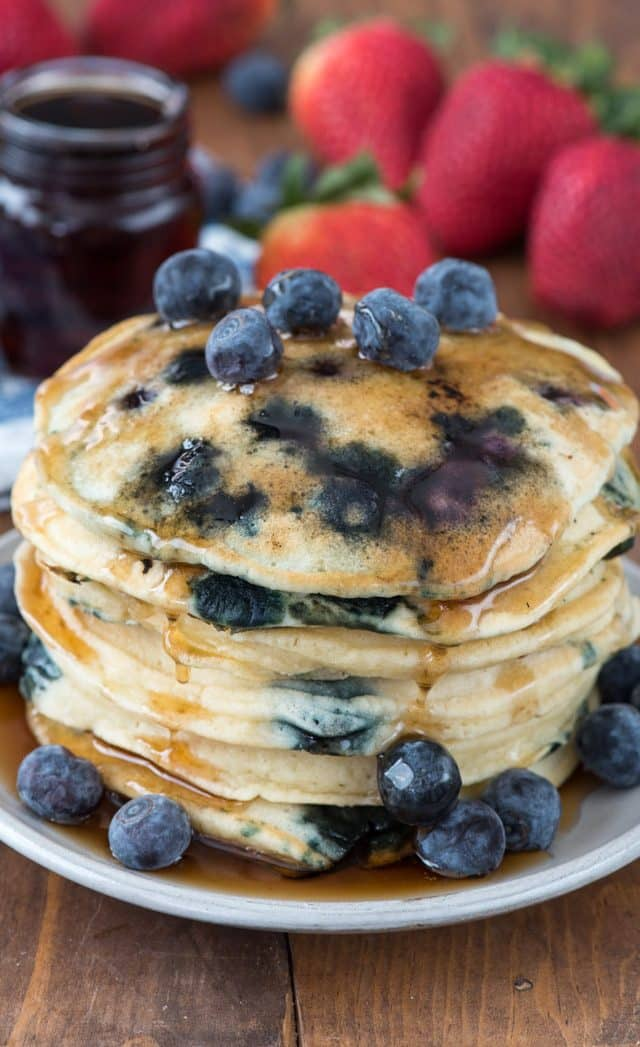 fluffy blueberry pancakes on white plate