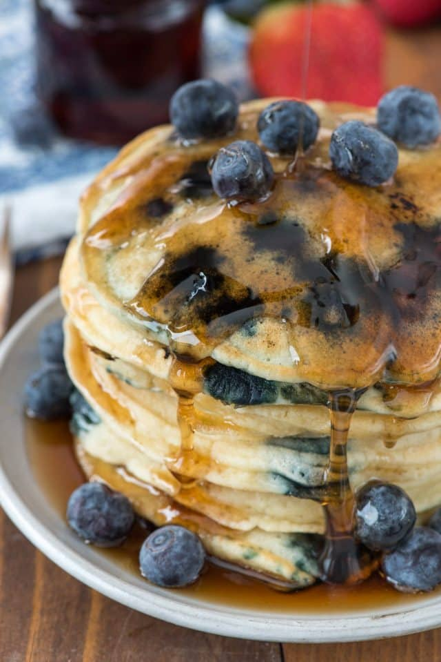 stack of blubbery pancakes on white plate